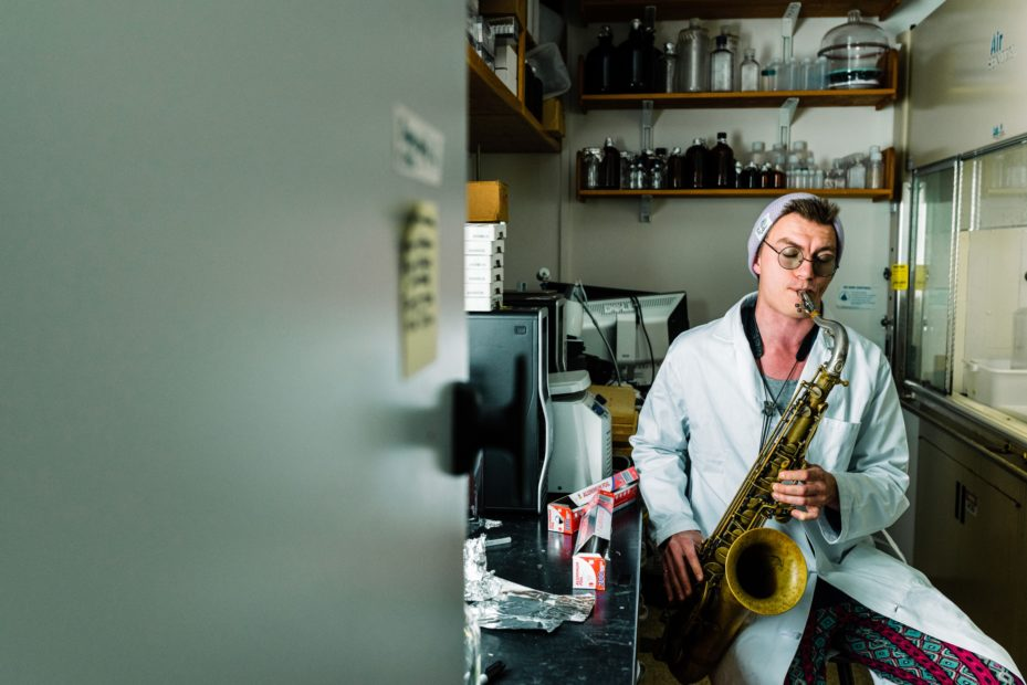 Student plays saxophone in lab
